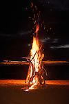 Rakiraki, Viti Levu, Fiji; a bonfire on the beach at sunset