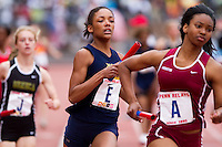 Caela Wiliams of West Catholic chases down Nicole Grasty of Abington in the High School Girls' 4x400 Philadelphia Area at the Penn Relays on April 24. West Catholic won the race in 3:48.48.