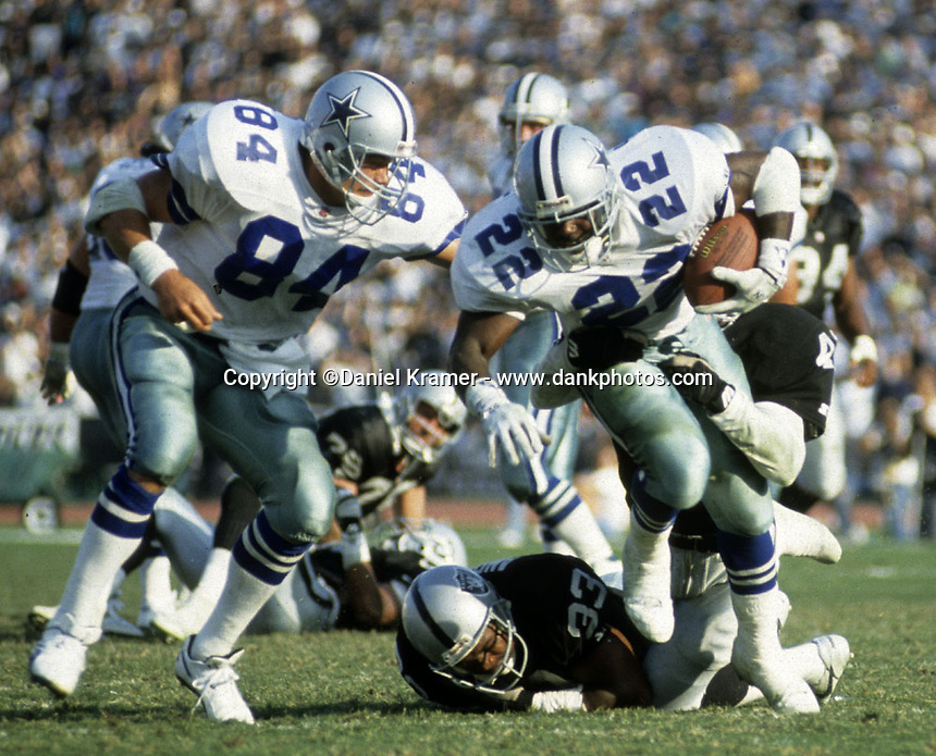 Dallas Cowboys running back Emmitt Smith is tackled by Raiders Eddie Anderson and Ronnie Lott on October 25, 1992. The Cowboys prevailed 28-13 and Smith rushed for 152 yards and three touchdowns at the Los Angeles Memorial Coliseum.