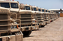 Army cargo trucks sit on a supply line at Joint Base Balad August 27, 2010.  The U.S. Army's 103rd Expeditionary Sustainment Command at Balad is one of two large scale logistics centers in Iraq responsible for helping move supplies and equipment to support the remaining just under 50,000 remaining U.S. Forces in Iraq.   .Slug: Iraq