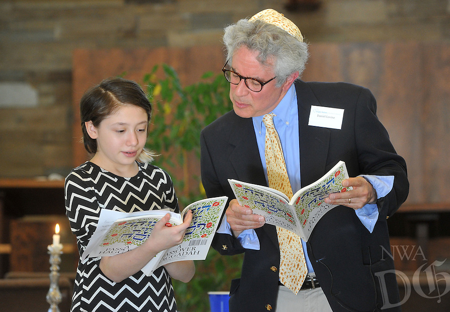 NWA Democrat-Gazette/MICHAEL WOODS &bull; @NWAMICHAELW<br /> Lena Hart, member of Temple Shalom of Northwest Arkansas is helped by Daniel Levine as she reads the Mah Nishtanah, the Four Questions, during the community Passover Seder on Saturday, April 23, 2016, in Fayetteville.  The Passover Seder tells the story of the Exodus from Egypt beginning with the Four Questions to explain why this night is different from all other nights.