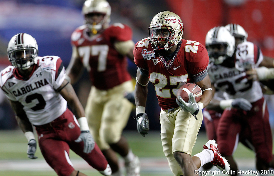 ATLANTA, AG 12/31/10-FSU-SC FB10 CH-Florida State's Chris Thompson heads for the endzone against South Carolina as he score's the Seminole's first touchdown during first half action Friday at the Chick-fil-A Bowl in Atlanta...COLIN HACKLEY PHOTO