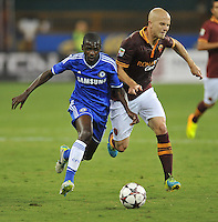 Michael Bradley (4) of AS Roma goes against Ramirez (7) of Chelsea FC.  Chelsea FC defeated AS Roma 2-1, during an international friendly , at RFK Stadium, Saturday August 10 , 2013.