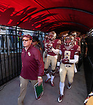 Personal Work<br /> <br /> The shadows of Seminole fans silhouette the canopy as Florida State head coach Jimbo Fisher leads his team through the tunnel to play the Florida Gators in an NCAA football game in Tallahassee, November 29, 2014.