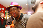 Debraun Thomas laughs with his beer during the Mardi Gras celebration at Bourbon and Toulouse in Lexington, Ky., on Tuesday, February 12, 2013. Photo by Genevieve Adams | Staff