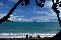 Young women tourists relaxing on third beach in Manuel Antonio National Park, Costa Rica