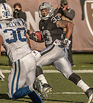 Oakland Raiders running back DeAndre Washington (33) runs for touchdown on Saturday, December 24, 2016, at O.co Coliseum in Oakland, California.  The Raiders defeated the Colts 33-25.