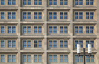 Windows of the Berolinahaus, built 1929-32 by Peter Behrens, used for retail and offices, on the Alexanderplatz, Berlin, Germany. This classical modernist building has been protected since 1975 as an example of the Neuen Sachlichkeit or New Objectivity style. Picture by Manuel Cohen