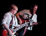 "Fifth-grader Ian Campbell plays with Brad Cook of Megafaun during their set at the annual Save Our Arts bennifit for Durham's Central Park School for Children on Friday. Campbell self-released a solo album entitled ""Dear B.P,"" wich includes a track entitled ""Stop Screwing Up The Gulf of Mexico."""
