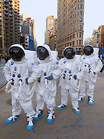 USA. New York City. Four astronauts dressed with spacesuits for the launch of a new  Mini car, the British automotive marque owned by BMW. Flat Iron Building in Manhattan. Union Square. 25.10.2011 &copy; 2011 Didier Ruef