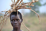 A woman in Yei, Southern Sudan, carries firewood home.