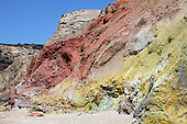 The geothermally active area around Paliochori Bay, Milos Island, Greece contains hydrothermally altered red and yellow cliffs with fresh fumarolic deposits at their base.