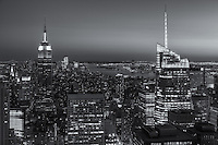 View looking south at twilight from the Top of the Rock including the Empire State Building, illuminated in Red/White/Green in honor of Columbus Day, and other Manhattan skyscrapers.  The rising Freedom Tower at the World Trade Center can be seen on the horizon to the right of the ESB.