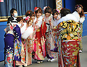 January 9, 2012, Chiba, Japan - Young Japanese boys and girls, all dressed up in fine suits and long-sleeved kimono dresses, celebrate the Coming of Age Day at Tokyo Disneyland, east of Tokyo. As of January 1, 2012, an estimated 1.22 million Japanese turned 20 years old over the past year. (Photo by Natsuki Sakai/AFLO)
