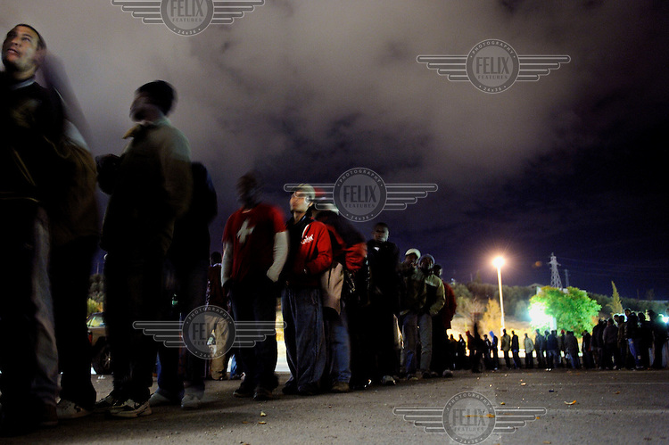 A line of unemployed immigrants queue for food at an aid centre in Jaen. Many of migrants come to the region to pick olives but this year there is competition for the work. The economic collapse means that work once shunned by the indigenous population is now sought after by unemployed Spaniards.