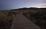 California, east central, Lee Vining. The boardwalk from the south shore tufa area on Mono Lake after sunset in autumn.