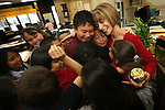 Mirta Torres is mobbed by her third-grade class at Spring Creek Elementary School after recieving the Golden Apple Award in Lee County Wednesday morning. Toress is one of several teachers in Lee Cpounty to recieve the teaching award of distinction. Erik Kellar/Staff