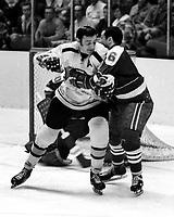 Seals vs Boston Bruins, Phil Esposito battles Seals Dick Mattiussi. (1970 photo/Ron Riesterer)