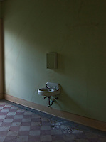 Nun dormitory room with sink in abandoned Holy Cross Anglican Church in downtown Vicksburg, Mississippi