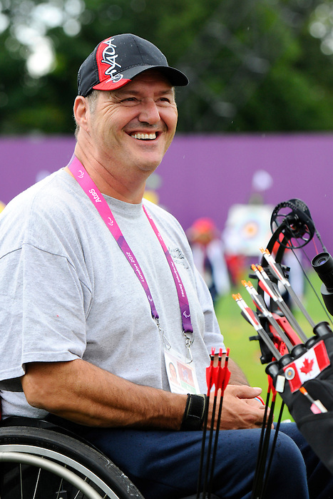 LONDON, ENGLAND 27/08/2012 - Norbert Murphy of the Canadian Paralympic Archery Team relaxes after a shot during a training session at the London 2012 Paralympic Games at The Royal Artillery Barracks. (Photo: Phillip MacCallum/Canadian Paralympic Committee)