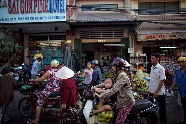 Vietnamese shop at a fruit store in Ho Chi Minh City...Kevin German / LUCEO