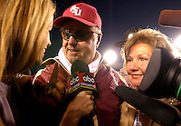 TALLAHASSEE, FL. 10/25/03-FSU Coach Bobby Bowden, center,  and wife Ann, right, are interviewed after Bowden won his 339th career game making him the winningest active Division 1A Coach. The Seminoles beat Wake Forest 48-24  Saturday at Doak Campbell Stadium in Tallahassee...COLIN HACKLEY PHOTO