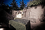 """The Franklin Delano Roosevelt (FDR) Memorial in Washington, DC houses four outdoor galleries, or rooms, each one commemorating a different segment of his presidency.  Quiet cascades of water flow throughout the memorial, and FDR quotes, such as """"I hate war"""" are engraved into large rocks and stone walls."""
