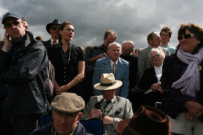 Goodwood Revival, 2007.Grandstand chic. The Goodwood revival is one of the largest historic car races events in the world; 3 days of racing at the highest level with some of the best pilots past and present driving historically important cars to the limit...and sometimes beyond! 110 000 spectators and participants gather in period costumes for a unique event.