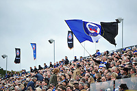 A Bath Rugby fan in the crowd waves a giant flag in support. Aviva Premiership match, between Bath Rugby and Exeter Chiefs on October 17, 2015 at the Recreation Ground in Bath, England. Photo by: Patrick Khachfe / Onside Images