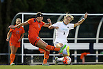 24 September 2015: North Carolina's Summer Green (6) blocks a clearance attempt by Syracuse's Erin Simon (3). The University of North Carolina Tar Heels hosted the Syracuse University Orange at Fetzer Field in Chapel Hill, NC in a 2015 NCAA Division I Women's Soccer game. UNC won the game 3-1.