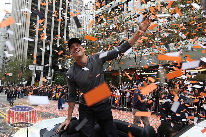 SAN FRANCISCO - OCTOBER 31:  Hunter Pence of the San Francisco Giants waves to the fans on Market Street during the World Series parade on October 31, 2012 in San Francisco, California. (Photo by Brad Mangin)