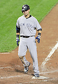 New York Yankees right fielder Nick Swisher (33) scores after hitting a 2 run home run in the seventh inning against the Baltimore Orioles at Oriole Park at Camden Yards in Baltimore, MD on Friday, August 26, 2011.  The Orioles won the game 12 - 5..Credit: Ron Sachs / CNP.(RESTRICTION: NO New York or New Jersey Newspapers or newspapers within a 75 mile radius of New York City)