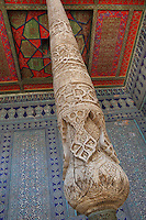 View from below of column in an aiwan terrace in the Harem, Tash Khauli Palace, 1830-38, Khiva, Uzbekistan, Khiva, Uzbekistan, pictured on July 6, 2010, in the morning. Commissioned by Allah Kuli Khan the Tash Kauli palace is a huge complex containing 163 rooms which took its architects, Tajiddin and Kalandar, 10 years to build. The harem, occupying about half of the palace has 5 aiwan terraces, with delicately carved wooden pillars,  behind which were the quarters for the khan and his wives. Khiva, ancient and remote, is the most intact Silk Road city. Ichan Kala, its old town, was the first site in Uzbekistan to become a World Heritage Site(1991). Picture by Manuel Cohen.