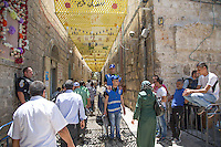 Palestinian Muslim worshippers is seen walking towards the Al-Aqsa Mosque in Jerusalem's Old City on July 26, 2013. Muslim worshippers attended the third Friday prayers of the holy month of Ramadan at the Al-Aqsa Mosque. Throughout the Ramadan, followers are required to abstain from food, drink and sex from dawn to dusk. Photo by Oren Nahshon