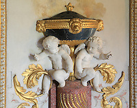 """Detail of putti which opened hands were designed to hold small torchs, Turkish Boudoir, redesigned in 1777 for Marie Antoinette, by architect Richard Mique, Chateau de Fontainebleau, France. The decoration is the achievement of the brothers Rousseau, and the furniture dates to the period of the First Empire, with precious textile work done by Jacob-Desmalter for Empress Josephine. Including a small bedroom, mirrors, and curtains raised by pulleys, this exceptional ensemble has been restored in 2014 thanks to the support of INSEAD and the generosity of subscribers of sponsors belonging to the group """"Des Mécènes pour Fontainebleau"""". Its opening to the public is schedule for Spring 2015. Picture by Manuel Cohen"""