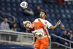11 December 2015: Syracuse's Noah Rhynhart (12) and Clemson's T.J. Casner (10). The Clemson University Tigers played the Syracuse University Orange at Sporting Park in Kansas City, Kansas in a 2015 NCAA Division I Men's College Cup Semifinal match. The game ended in a 0-0 tie after overtime; Clemson advanced to the Final by winning the penalty kick shootout 4-1.