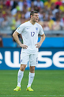 James Milner of England  looks dejected and shouts to his team mates