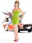 Beautiful blonde girl in little green dress with men in convertible triumph car behind her trying to get her attention.
