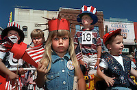 Talia Panelli, 3, dressed as the Statue of Liberty watches a Fourth of July parade with other patriotically dressed children in Colfax on July 4, 1997.