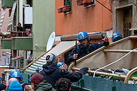 Rome, Italy. 16th February 2016<br /> Riot police breaks through the door of the building where he lives Mrs. Ida with her husband who have barricaded themselves in the house to resist to eviction, to Centocelle district. The picket anti-eviction seeks to block the eviction.