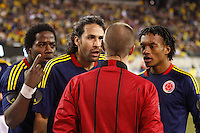 Colombian players (L_R) Carlos Sanchez, Mario Yepes and Juan Cuadrado argues with the referee Mark Geiger after a penalty call against Colombia during their friendly match with Brazil at MetLife Stadium in East Rutherford New Jersey, November 14, 2012. Photo by Eduardo Munoz Alvarez / VIEWpress.