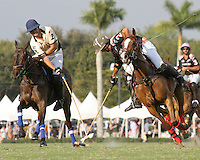 WELLINGTON, FL - FEBRUARY 05:  Joaquin Panela #2 of Valiente II and Lucas Criado #2 of Orchard Hill (dark blue) hook mallets while battling for the ball, during one of the early matches of the Ylvisaker Cup at the International Polo Club Palm Beach on February 05, 2017 in Wellington, Florida. (Photo by Liz Lamont/Eclipse Sportswire/Getty Images)