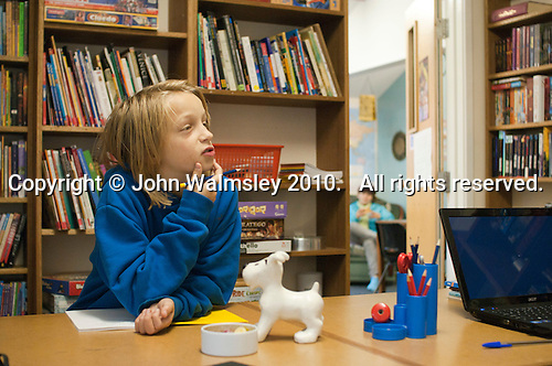 One of the kids in a Maths class, Summerhill School, Leiston, Suffolk. The school was founded by A.S.Neill in 1921 and is run on democratic lines with each person, adult or child, having an equal say.  You don't have to go to lessons if you don't want to but could play all day.  It gets above average GCSE exam results.