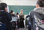 """Sawsan Al Khalili, 40 years-old, a Palestinian woman of special needs speaks to students in Gaza city on Feb. 11, 2017. Al Khalili secretary general of the general union of the Palestinian disabled and a head of the Palestinian farsat club for women with disabilities and she has a degree in law and information technology. """"I defend the rights of the disabled and became their ambassador in six European countries"""" Al Khalili said. Photo by Samar Eliwa"""
