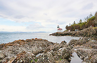 Lime Kiln Point Lighthouse, within Lime Kiln Point State Park, named for early mining industry in the San Juan Islands.  The actual lime kilns lie next door on land preserved by the San Juan Land Trust, San Juan Island, Washington State, USA