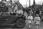 Belfast Orange Day Parade, British Army  keep watch. 1970.