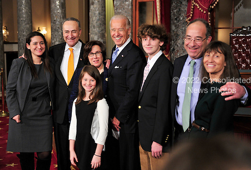 United States Senator Chuck Schumer (Democrat of New York), his wife, Iris Weinsall, and U.S. Vice President Joe Biden pose for a group photo with members of the Schumer family during the photo-op of the reenactment of his swearing-in in the Old Senate Chamber in the U.S. Capitol in Washington, D.C. on Wednesday, January 5, 2011.  Pictured are: Jessica Schumer, daughter; Senator Schumer; Ema Schumer, Niece; Ms. Weinsall, wife; VP Biden; Mac Schumer; Robert Schumer, brother; and Pam Seymon, sister-in-law..Credit: Ron Sachs / CNP.(RESTRICTION: NO New York or New Jersey Newspapers or newspapers within a 75 mile radius of New York City)