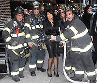 Salma Hayek poses with New York's city firemen