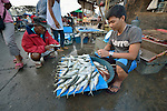 A man sells fish early in the morning in Tacloban, a city in the Philippines province of Leyte that was hit hard by Typhoon Haiyan in November 2013. The storm was known locally as Yolanda. The ACT Alliance has been active here and in affected communities throughout the region helping survivors to rebuild their homes and recover their livelihoods.