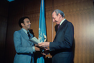The United Nations, New York City, New York - January 26, 1977. Photograph taken of Andrew Young being presented with accreditation to become the United States representative at the UN, by UN Secretary-General Kurt Waldheim. Andrew Young (born March 12, 1932) is an American activist, politician and diplomat, whom served as the Mayor of Atlanta from 1982-1990.